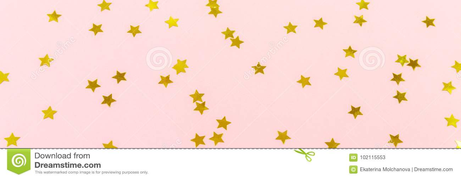 Golden star sprinkles on pink. Festive holiday background. Celeb
