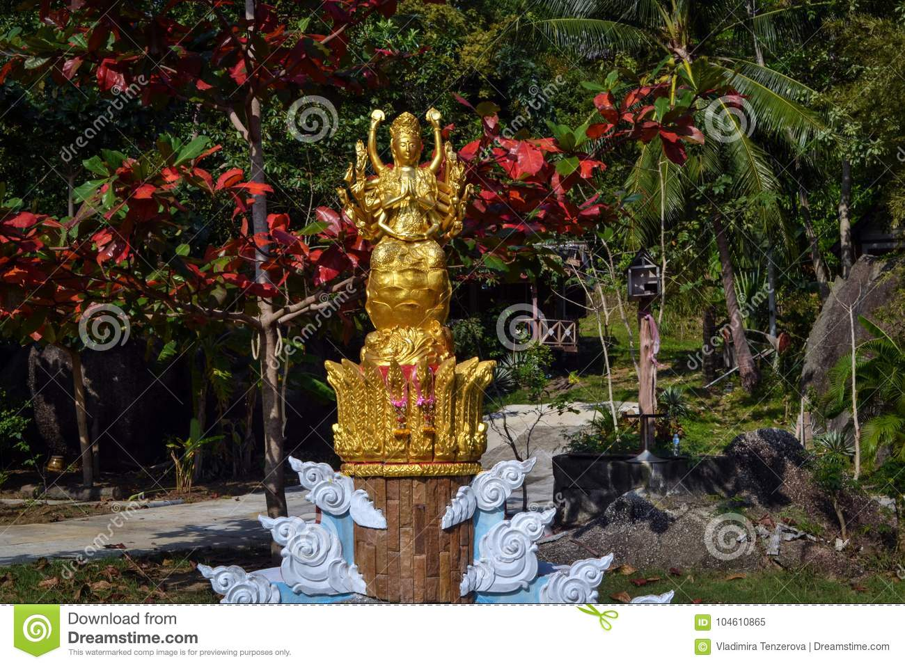 Golden Statue Of The Goddess In The Blooming Garden Buddhist Temple ...