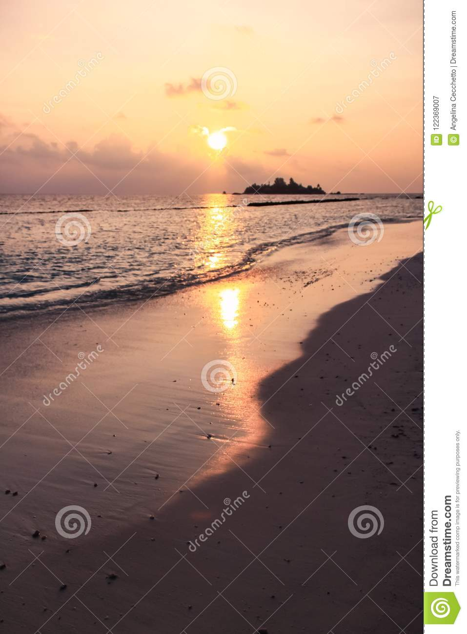 Sunset over Maldives Island Beach, Island and Pacific Ocean