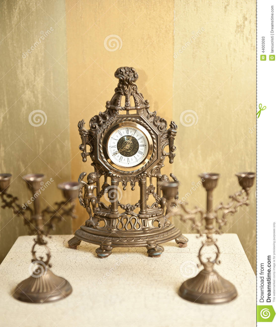 August 2014 Cpo Offers Table Jpg: Golden Vintage Metallic Clock With Two Candlesticks For