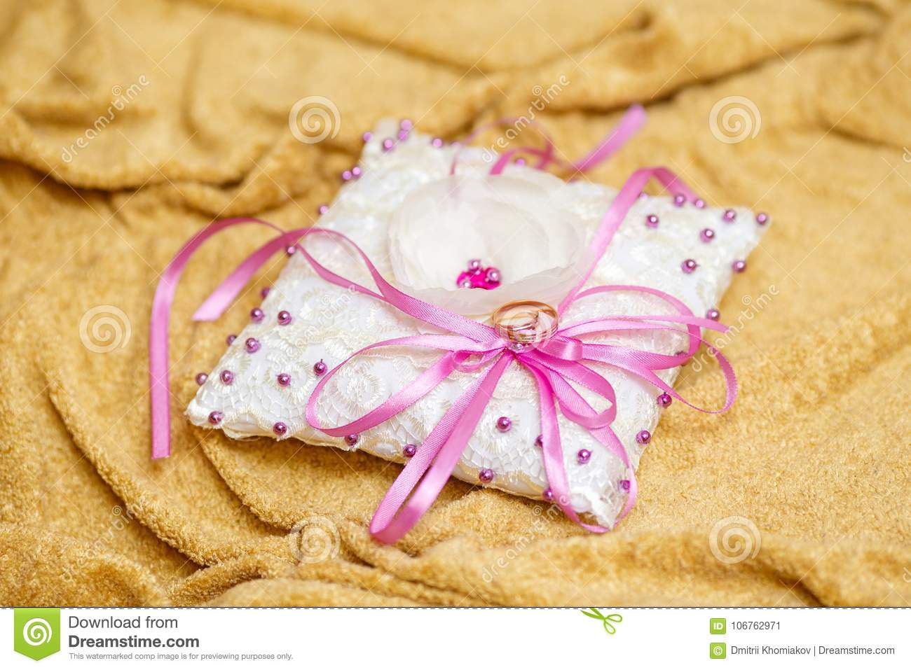 Golden Wedding Rings On Decorated Little White Pillow Stock Image ...