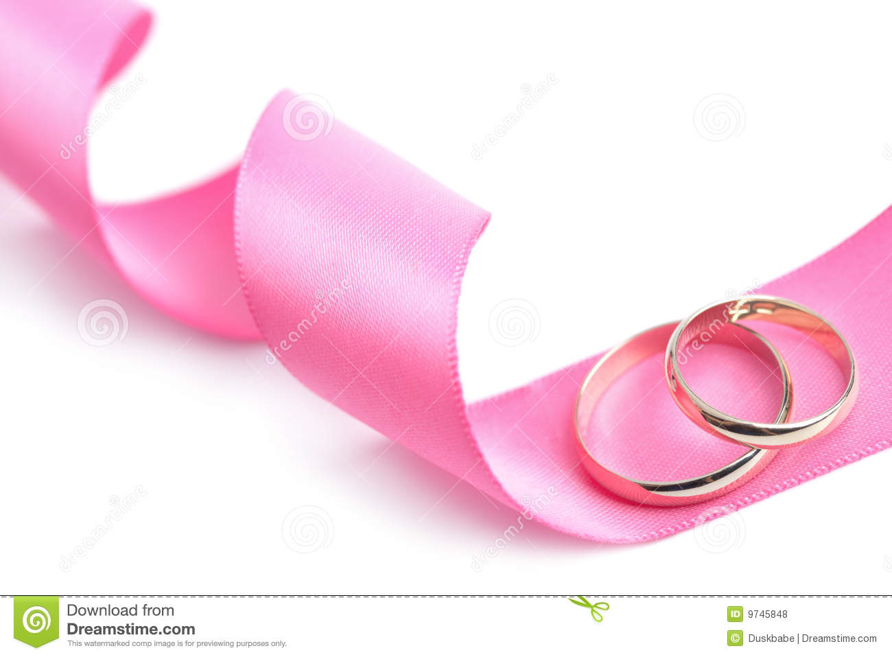 Golden Wedding Rings Over Pink Ribbon Isolated Stock Photo - Image ...