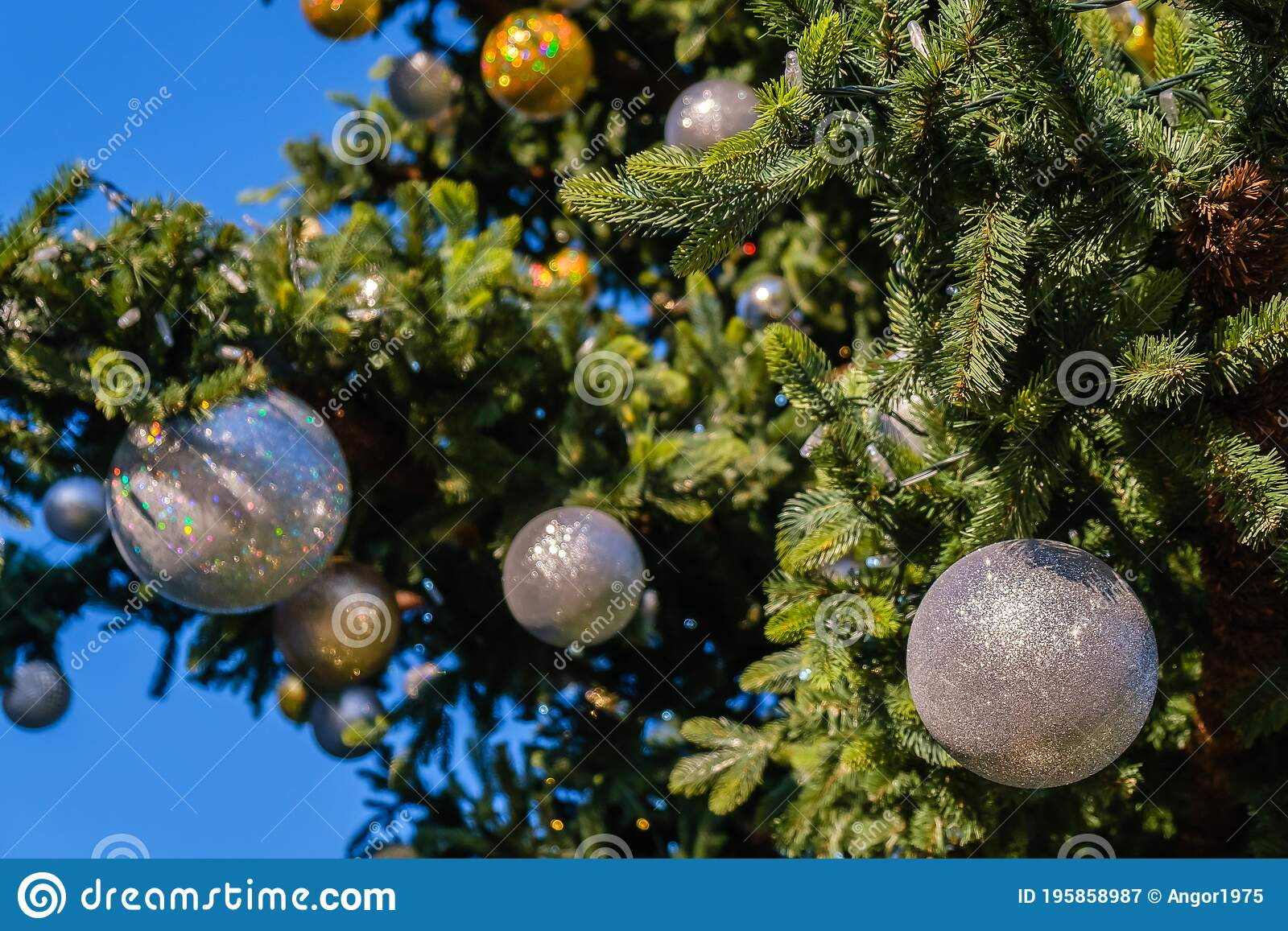 Golden And White New Year Decorations And Garland On A Branches Of Faux Christmas Tree Outdoors On Blue Sky Background At Sunny Stock Image Image Of Snow Christmas 195858987