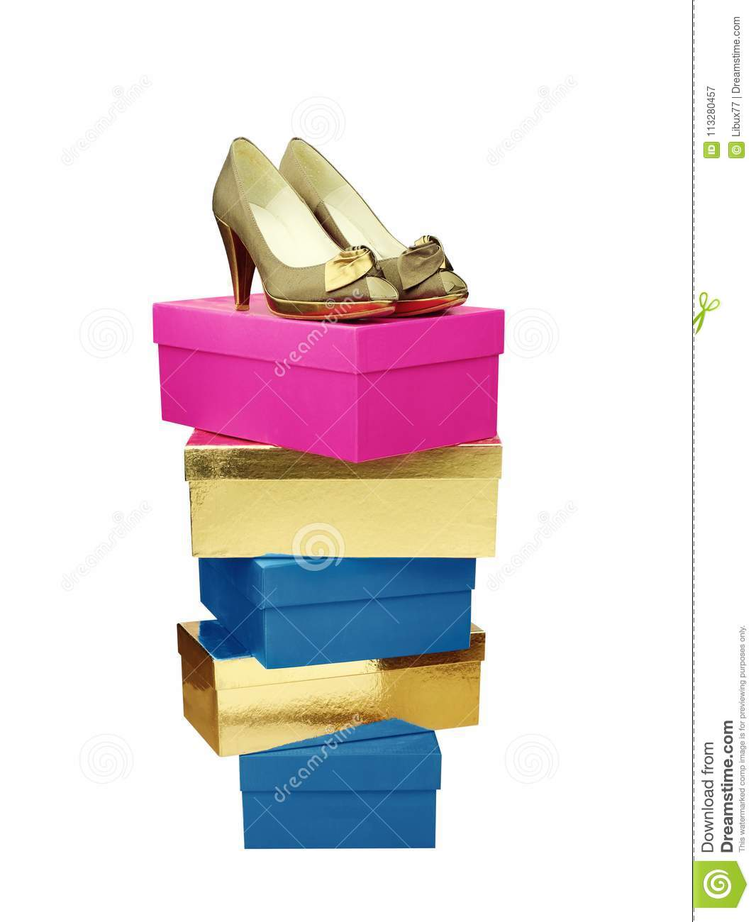 golden woman shoes on top of stacked boxes isolated stock image