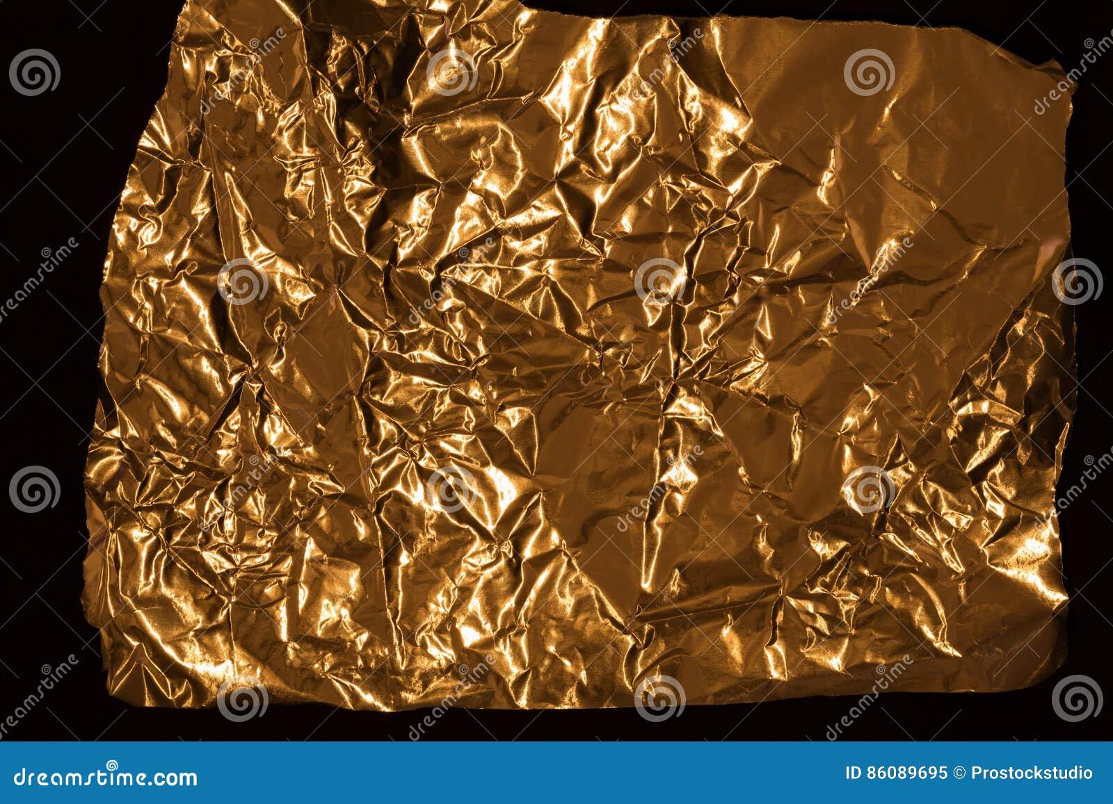 Golden wrinkled foil texture for background