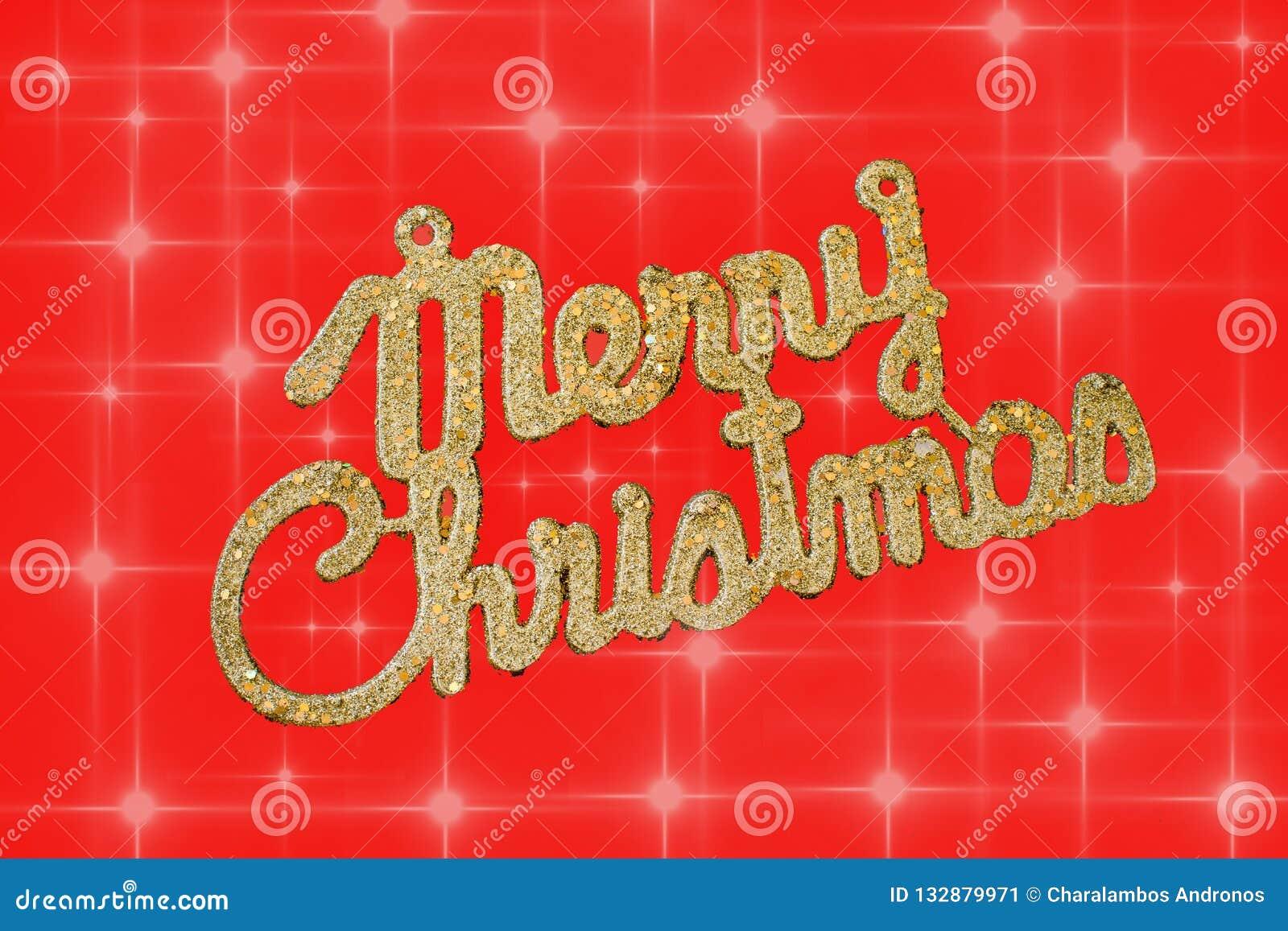Goldener Text der frohen Weihnachten auf einem roten Hintergrund mit Sternen