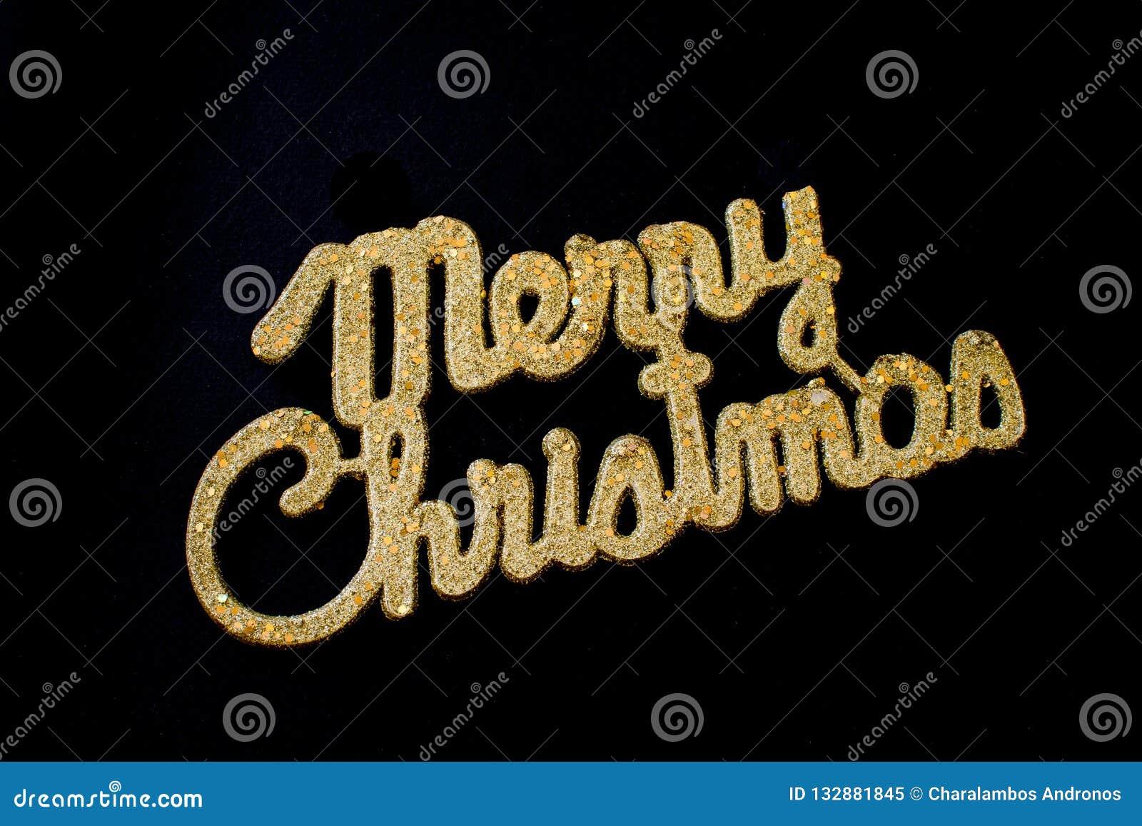 Goldener Text der frohen Weihnachten auf einem schwarzen Hintergrund
