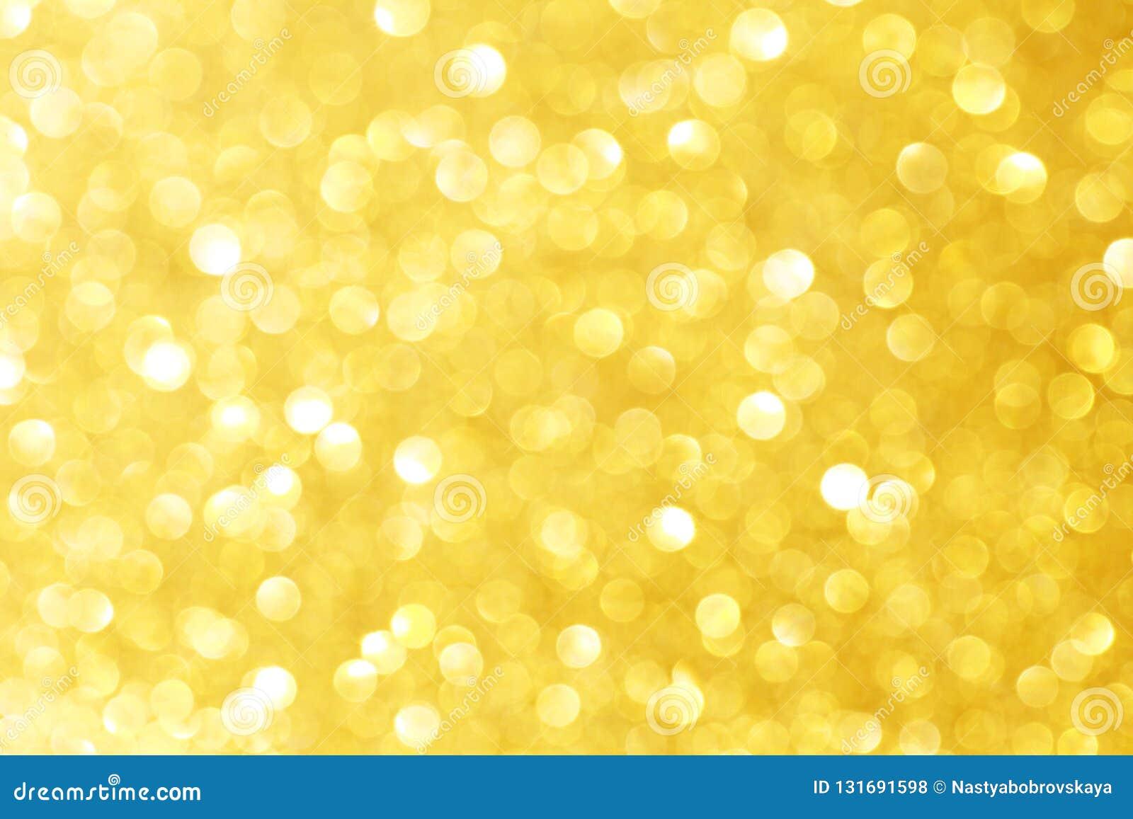 Goldenes Scheinfunkeln mit bokeh Effekt und Fokus selectieve Festlicher Hintergrund mit Lichtern des strahlenden Golds, Champagne