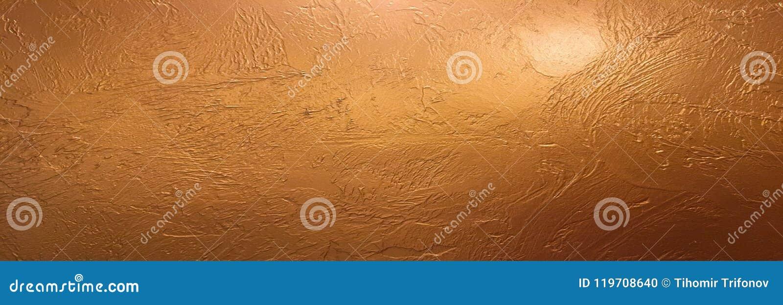 Goldhintergrund oder Beschaffenheits- und Steigungsschatten Glänzender gelber Blattgoldfolien-Beschaffenheitshintergrund Goldhint