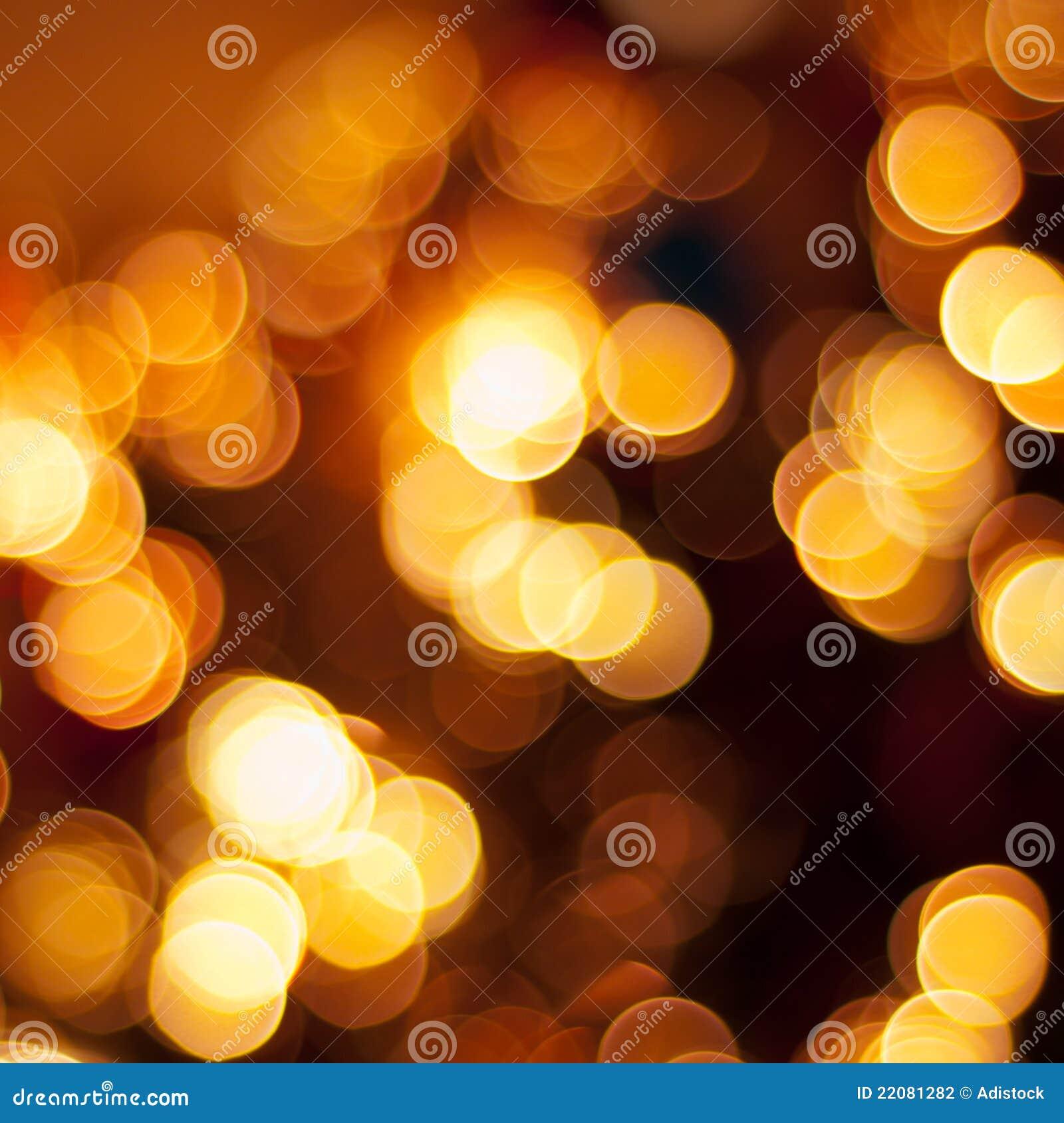 Goldweihnachtsleuchtehintergrund Stockfoto - Bild von nacht ...