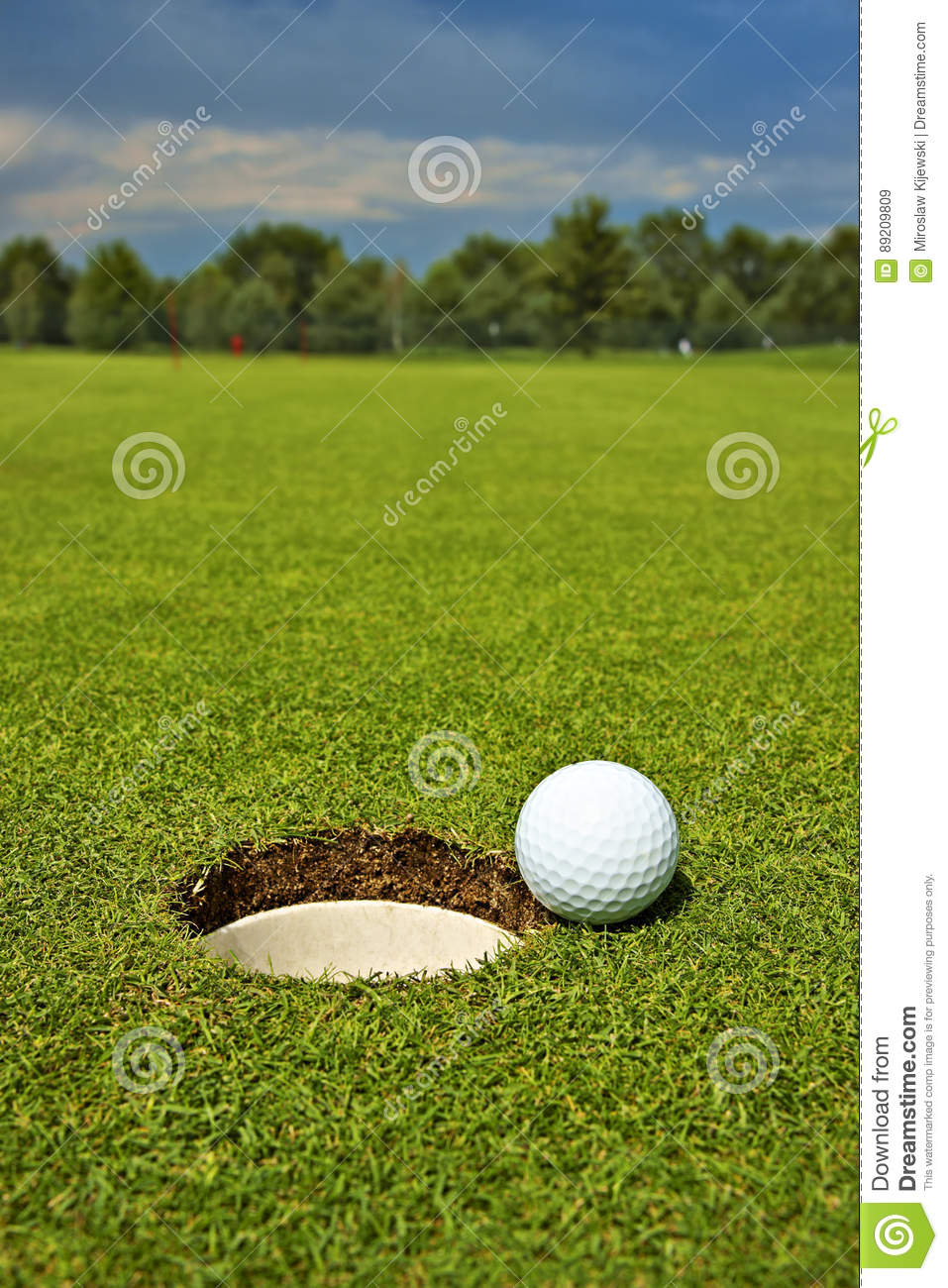 Golf, ball lying on the green next to hole