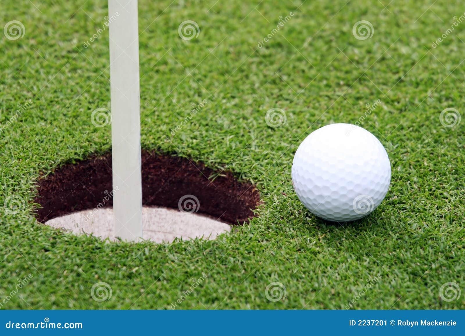Golf Ball near Pin