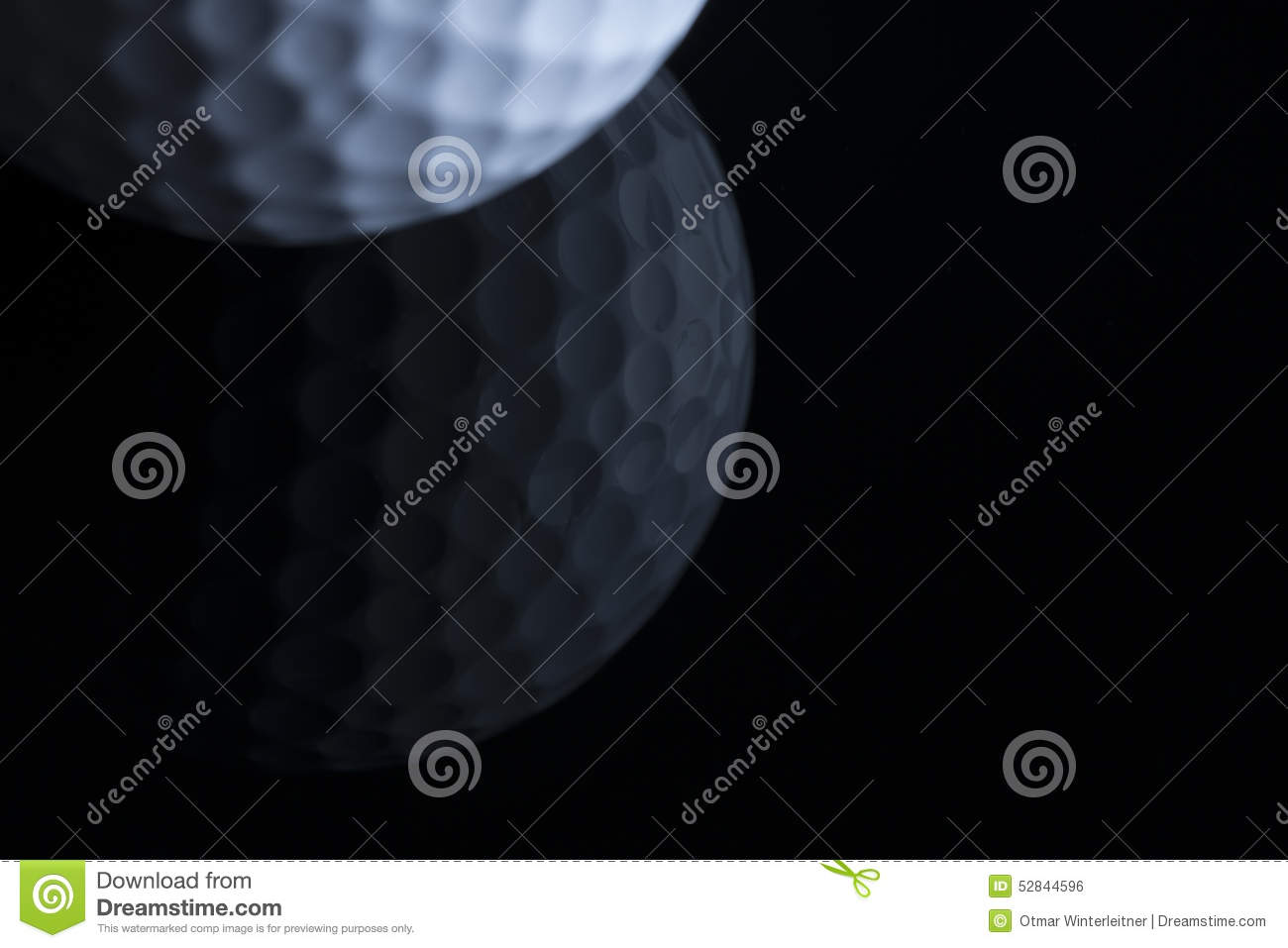 Golf ball with reflection isolated on black background.
