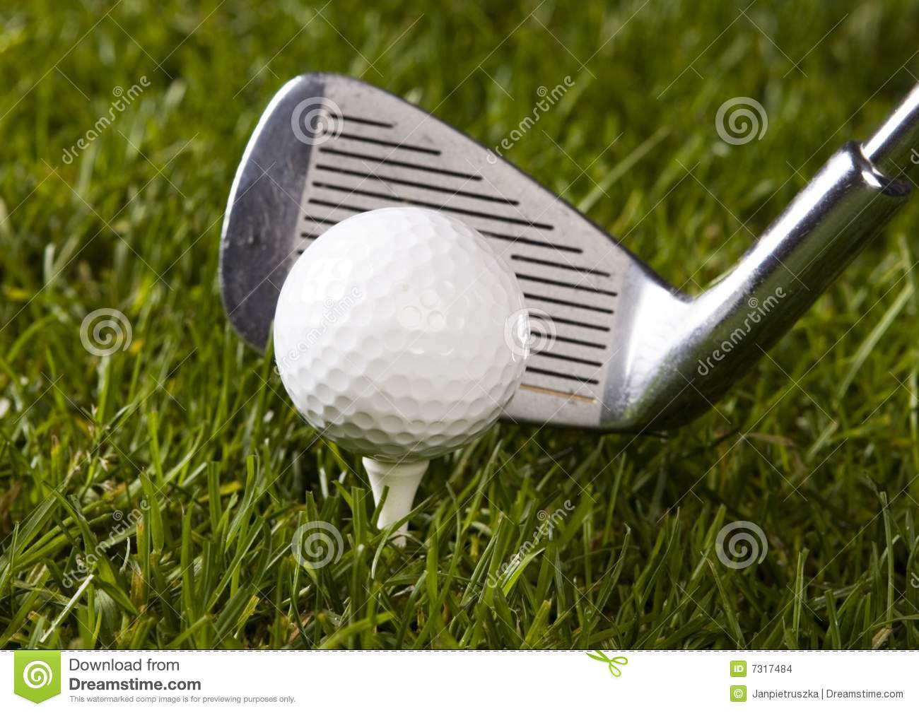 Golf ball on tee with club