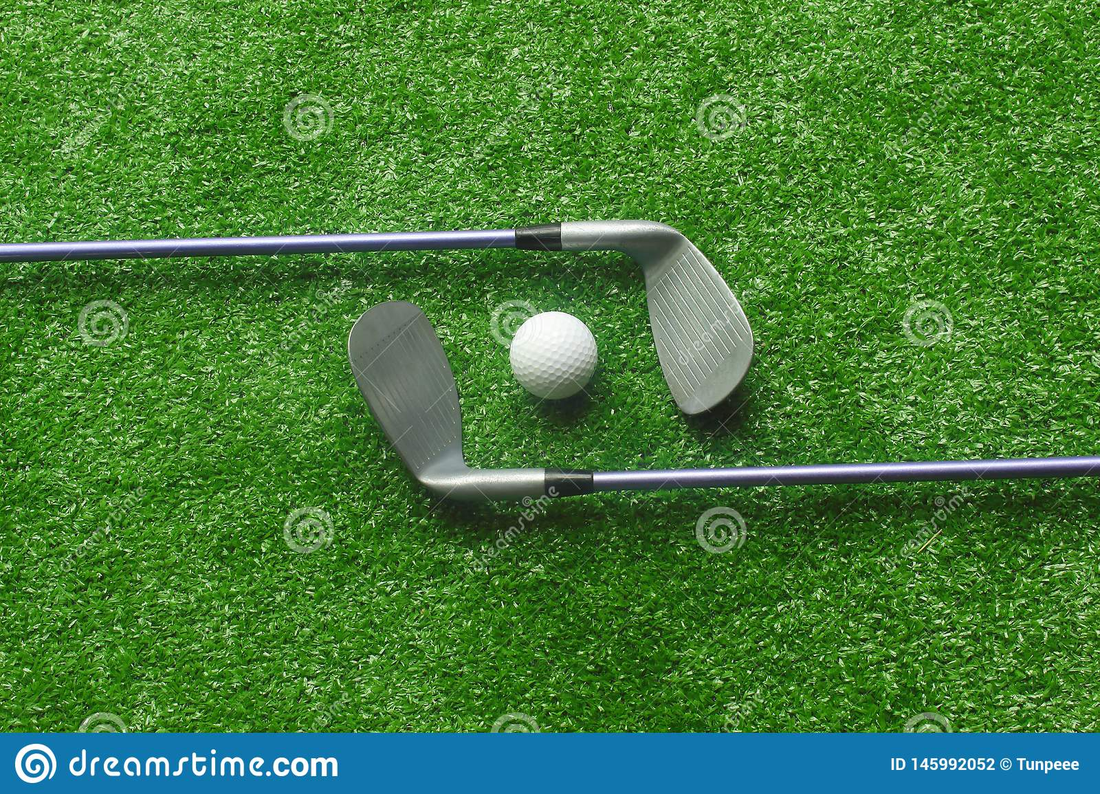 Golf Balls And Golf Clubs On Green Grass Stock Photo Image Of Hobby Club 145992052