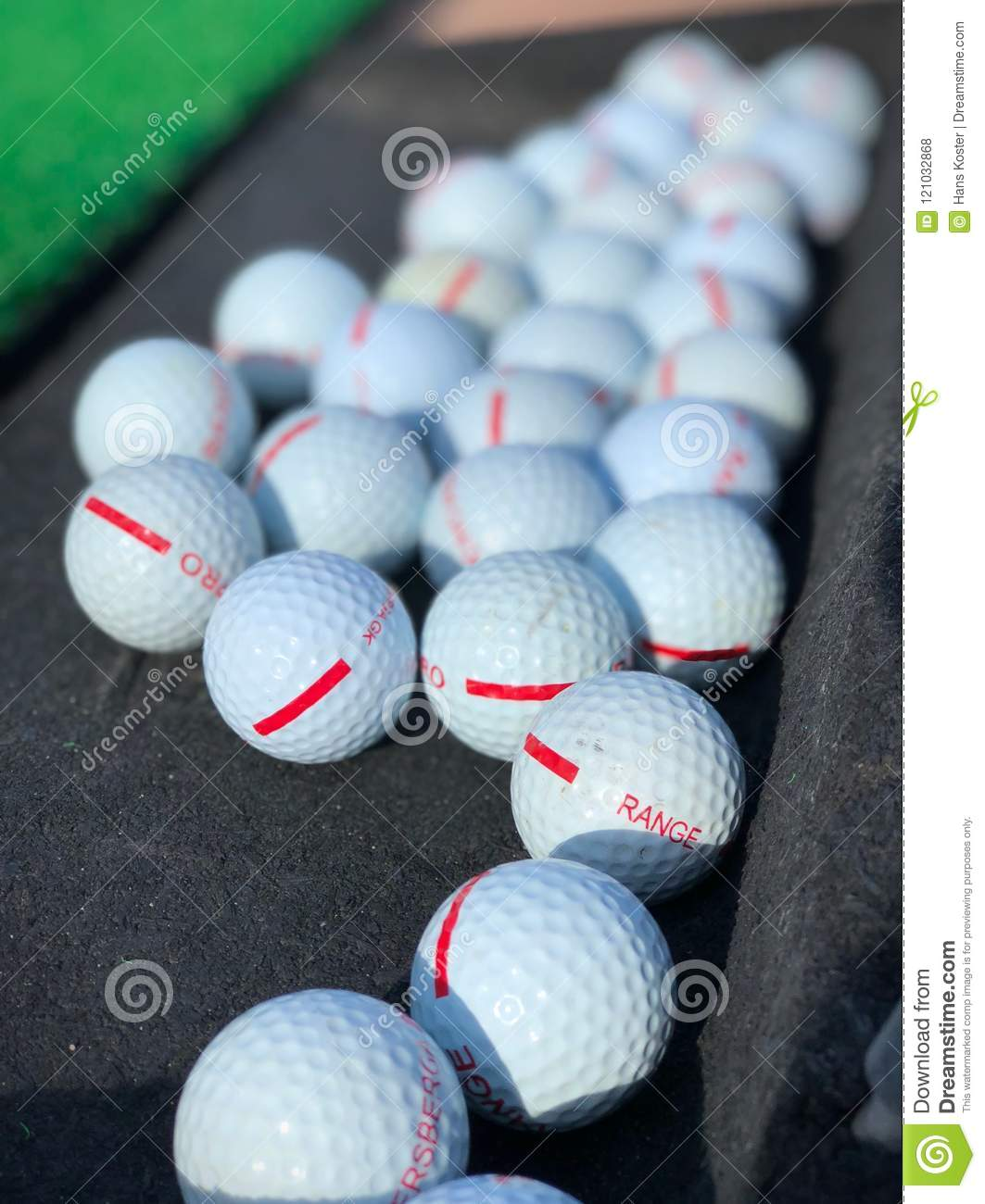 Golf balls on driving range ready to hit off