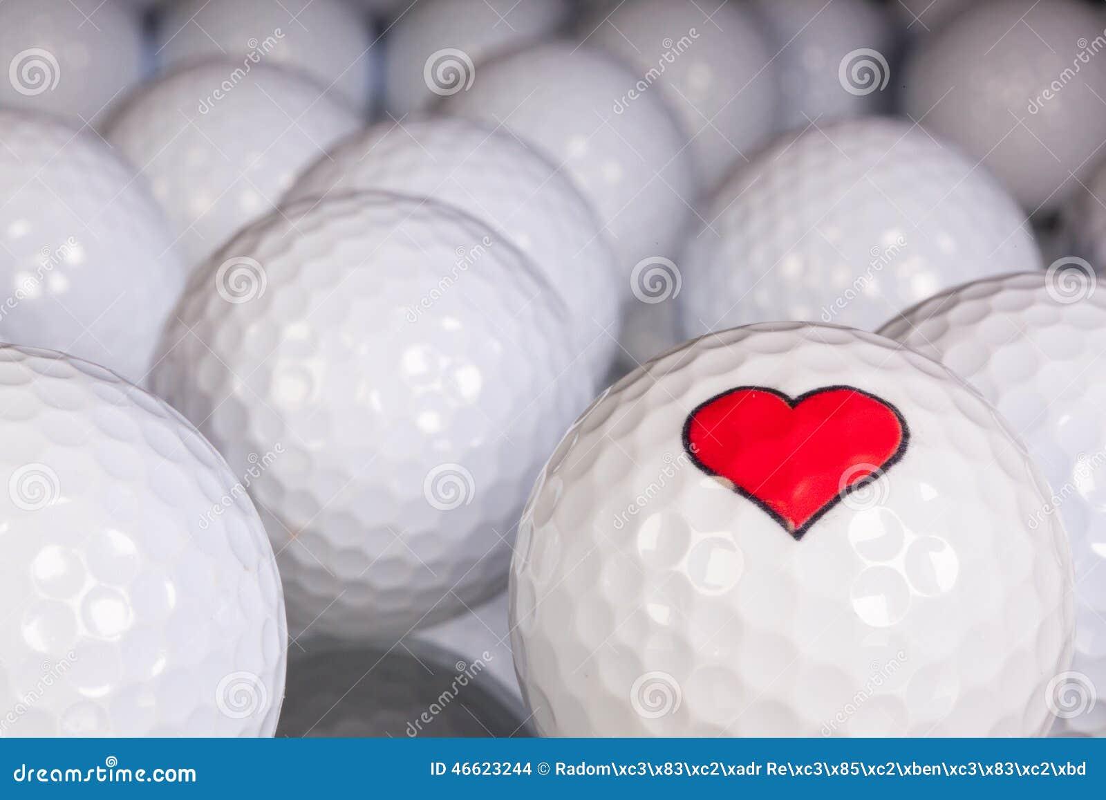 Golf balls with love symbol