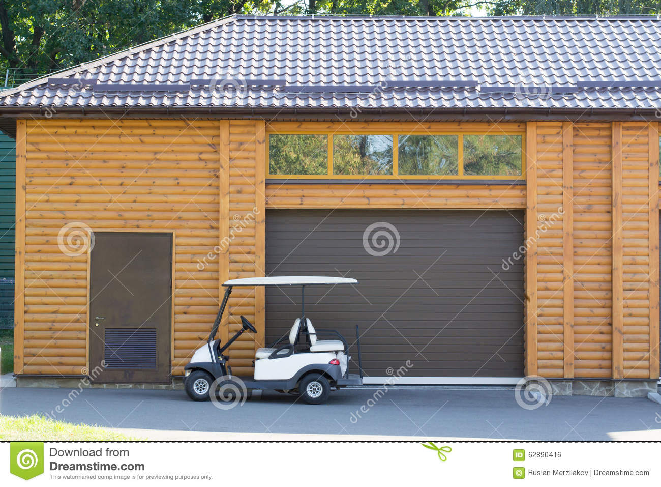 957 #986B33 Golf Cars Near The Wooden Garage With Windows And Door. picture/photo Garage Doors Near Me 37391300