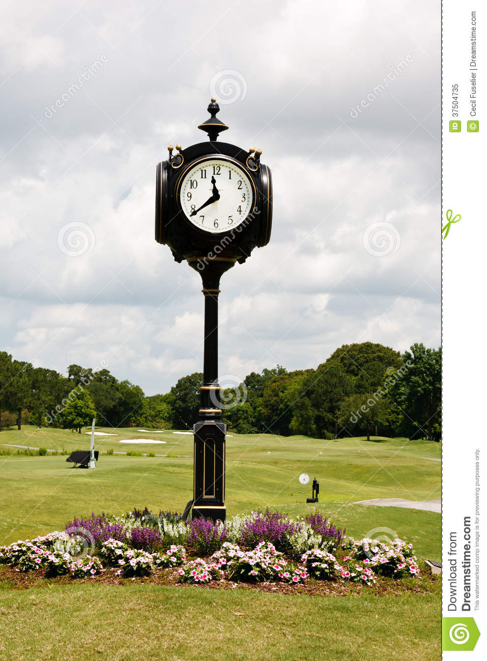 Golf Course Clock stock image. Image of pole, flowers , 37504735