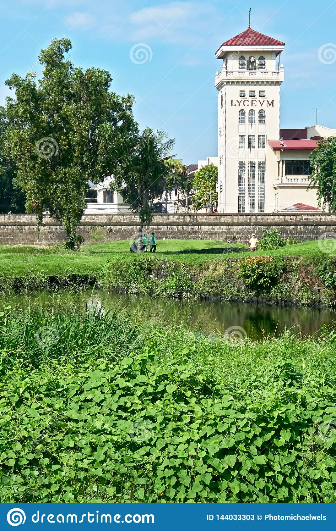 Golf course in front Intramuros wall and Lyceum University