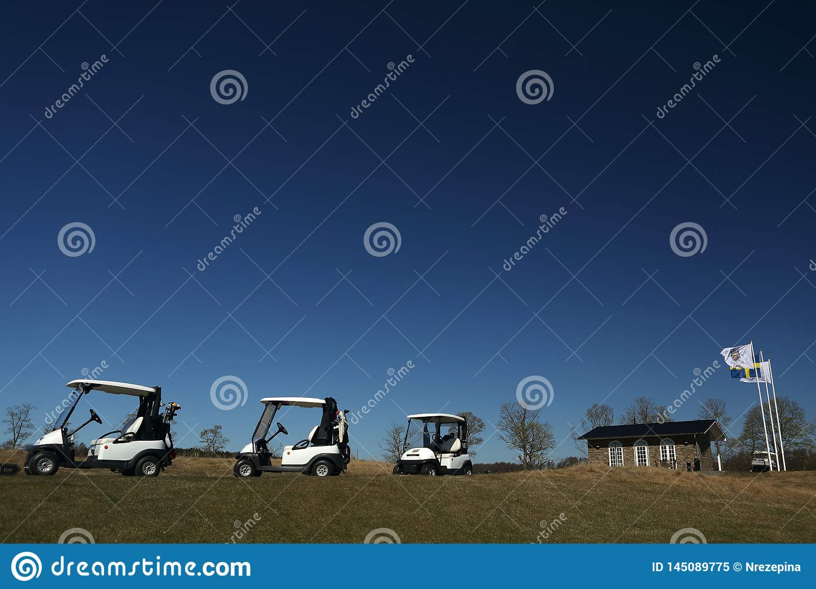 A golf course with golfcarts