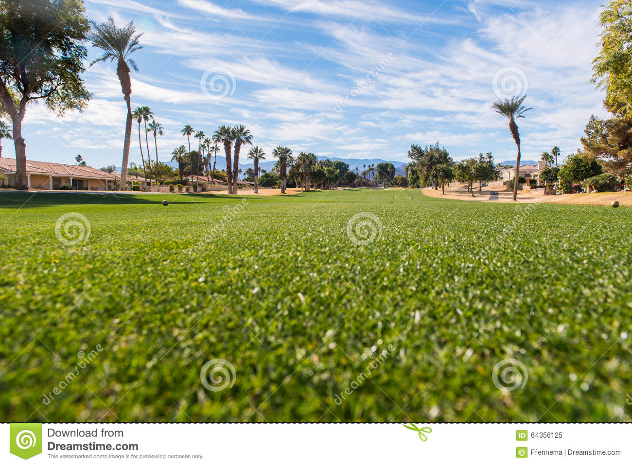 Golf Fairway Is Green Surrounded By Brown Rough Stock