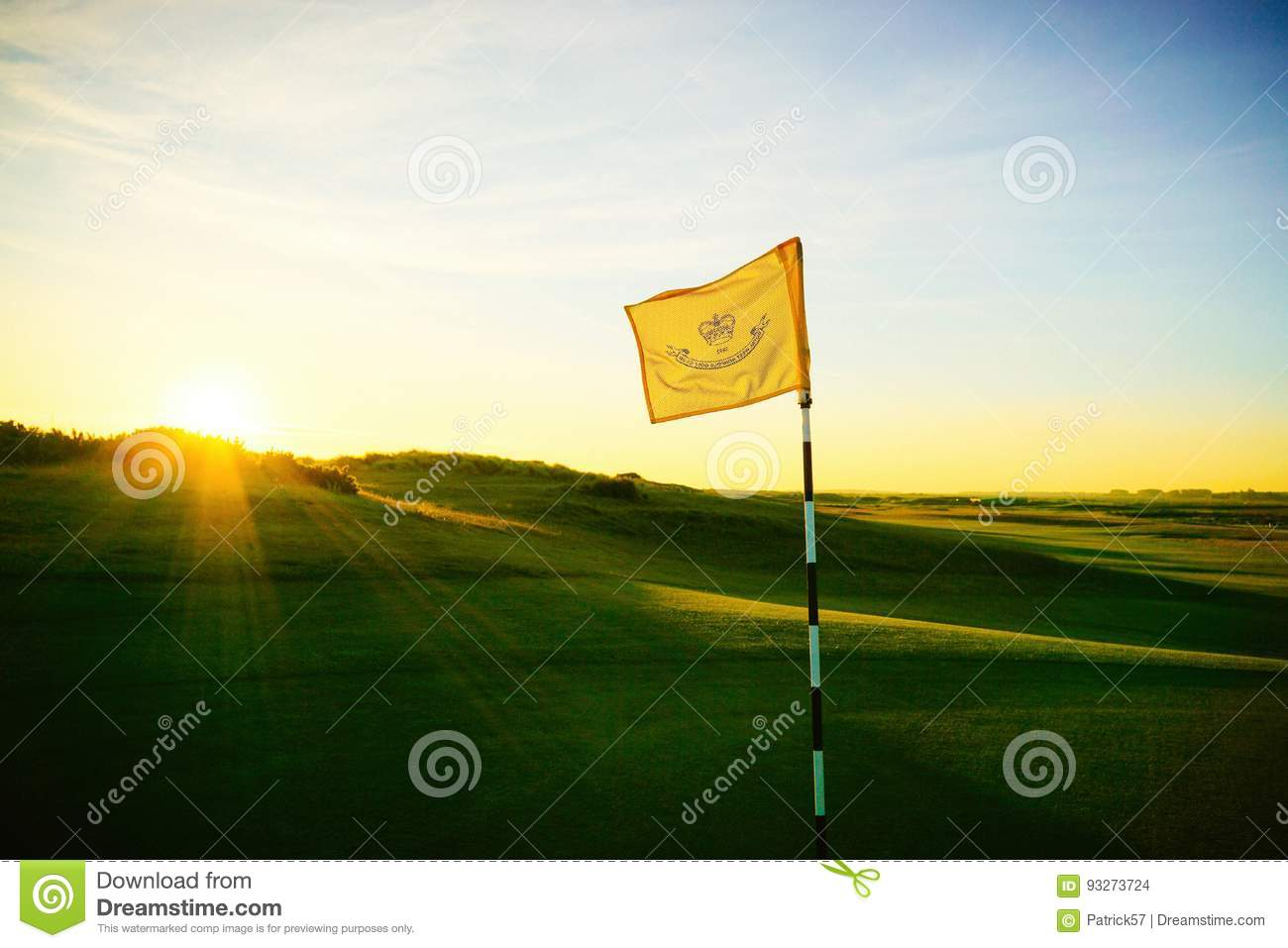 Golf course flag early morning.