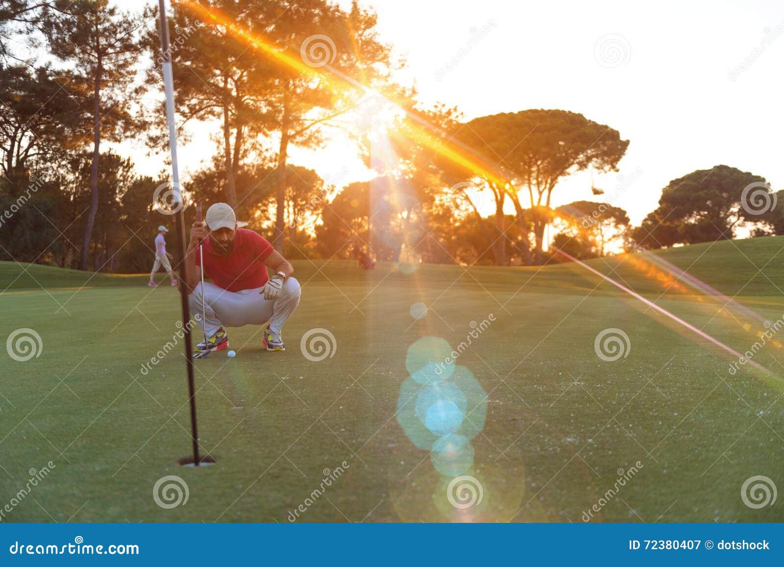 Golf player aiming perfect shot on beautiful sunset