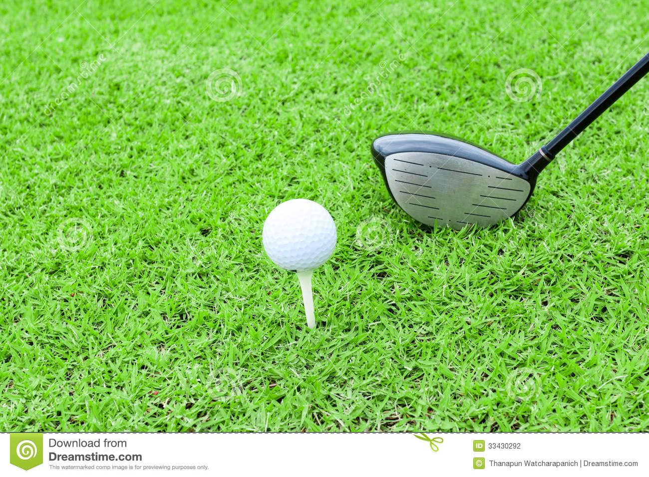 golf tee ball club driver in green grass course preparing to shot