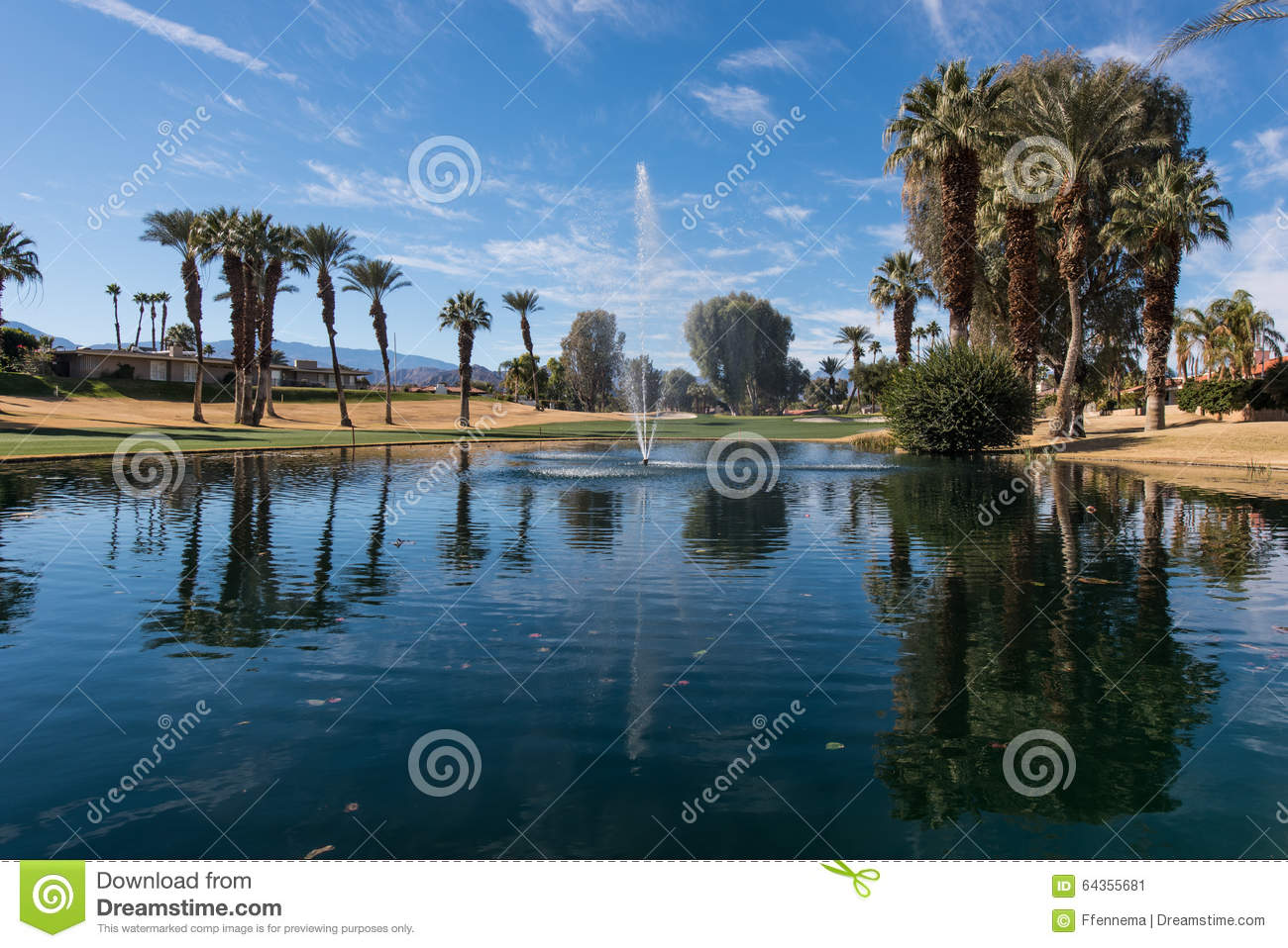 Golf water hazard with a fountain and trees