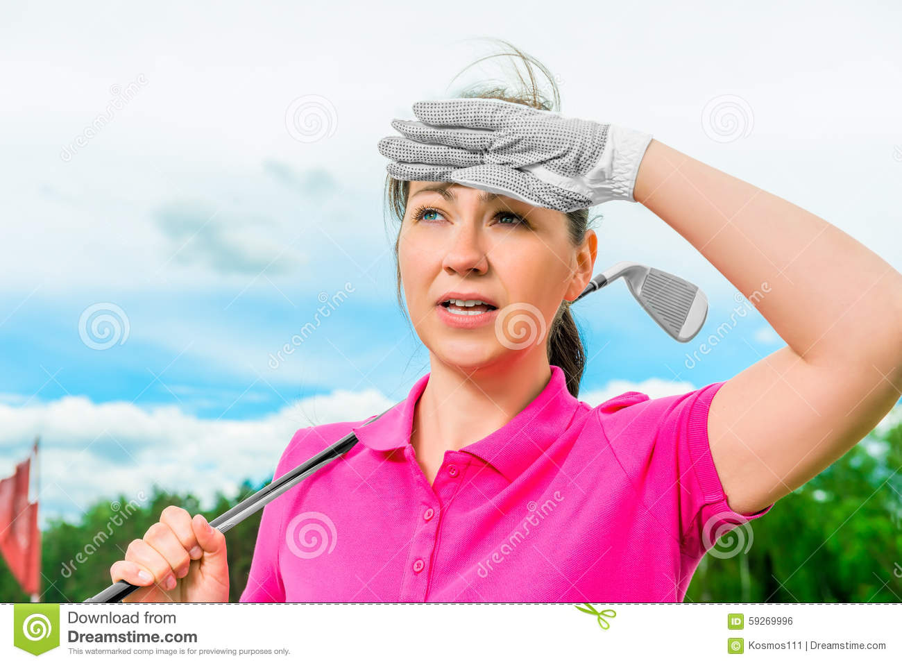Golfer looks into the ball flying high