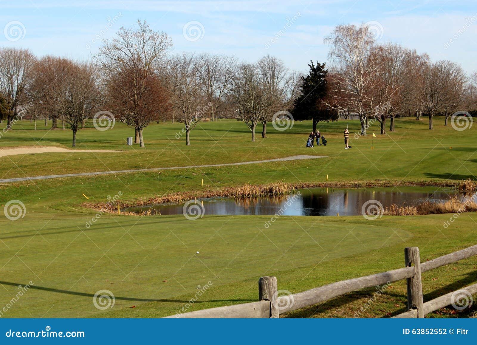 Golf course water hazard with golfers