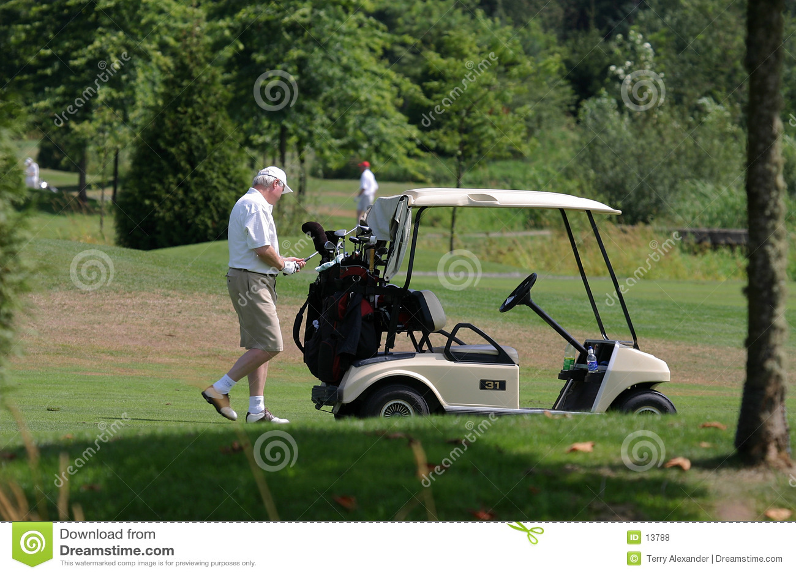 Golfeur et chariot de golf