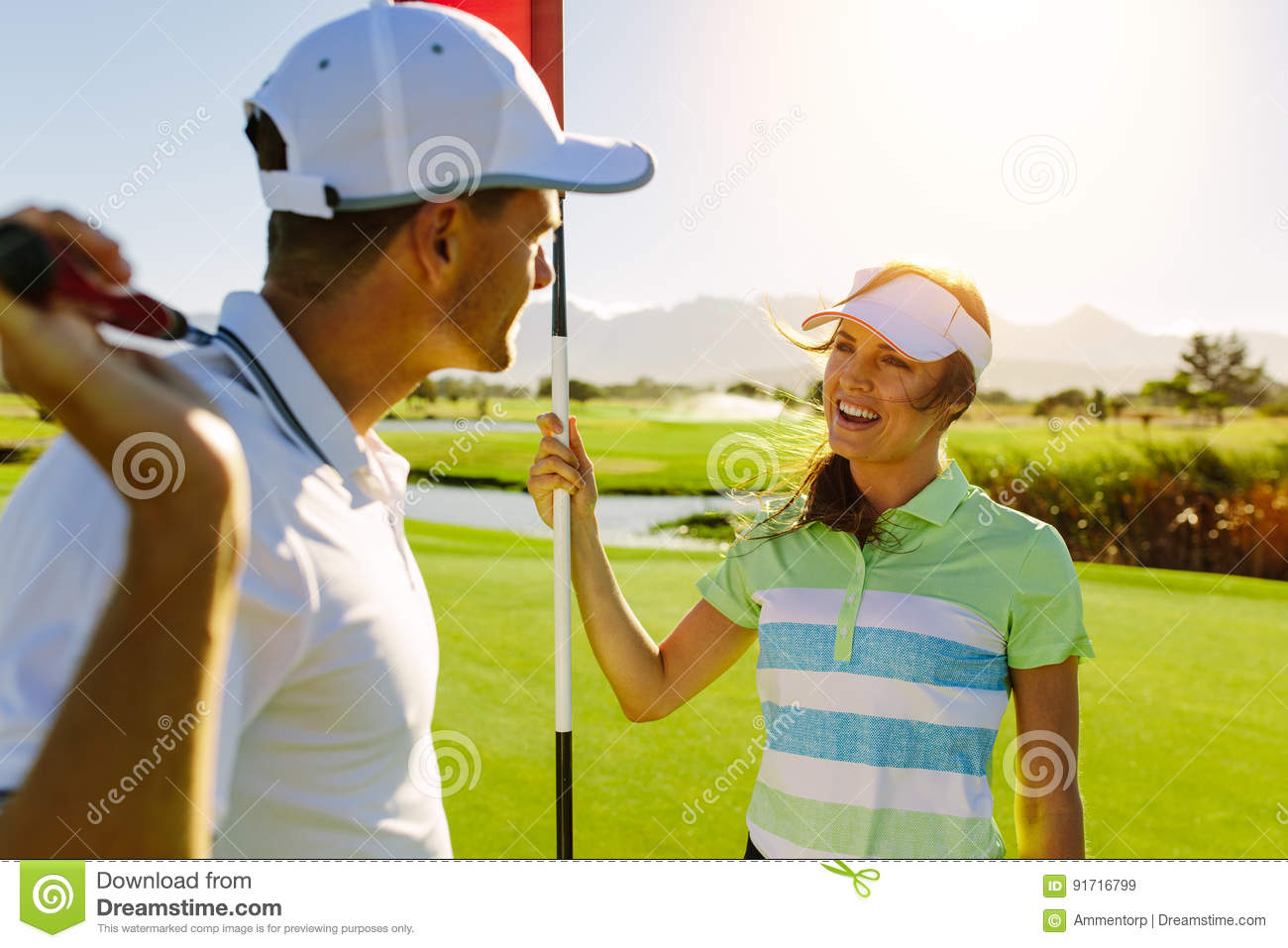 Golfing couple on the putting green at the golf course