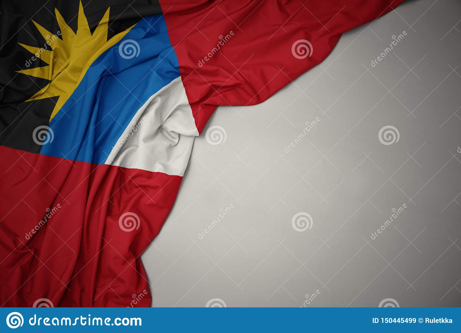 Golvende nationale vlag van antigua en Barbuda op een grijze achtergrond