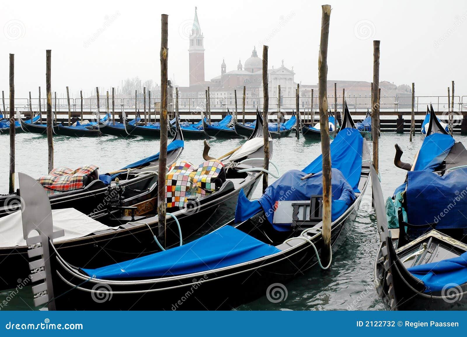 Gondola's in venice italy and san georgio maggiore in the background.