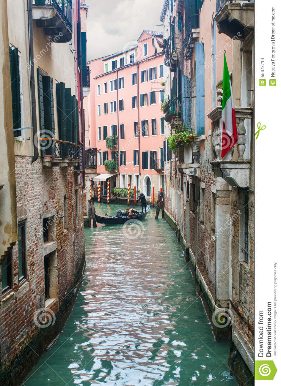 gondola with tourists in carnival time in venice editorial stock