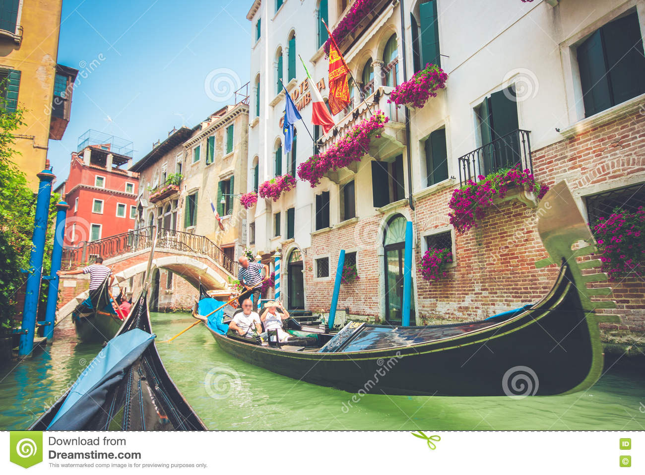 Gondolas on canal in Venice, Italy with retro vintage filter effect