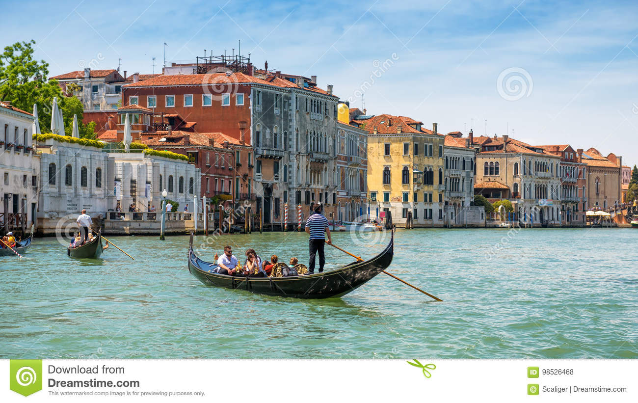 Gondolas are sailing along the Grand Canal in Venice