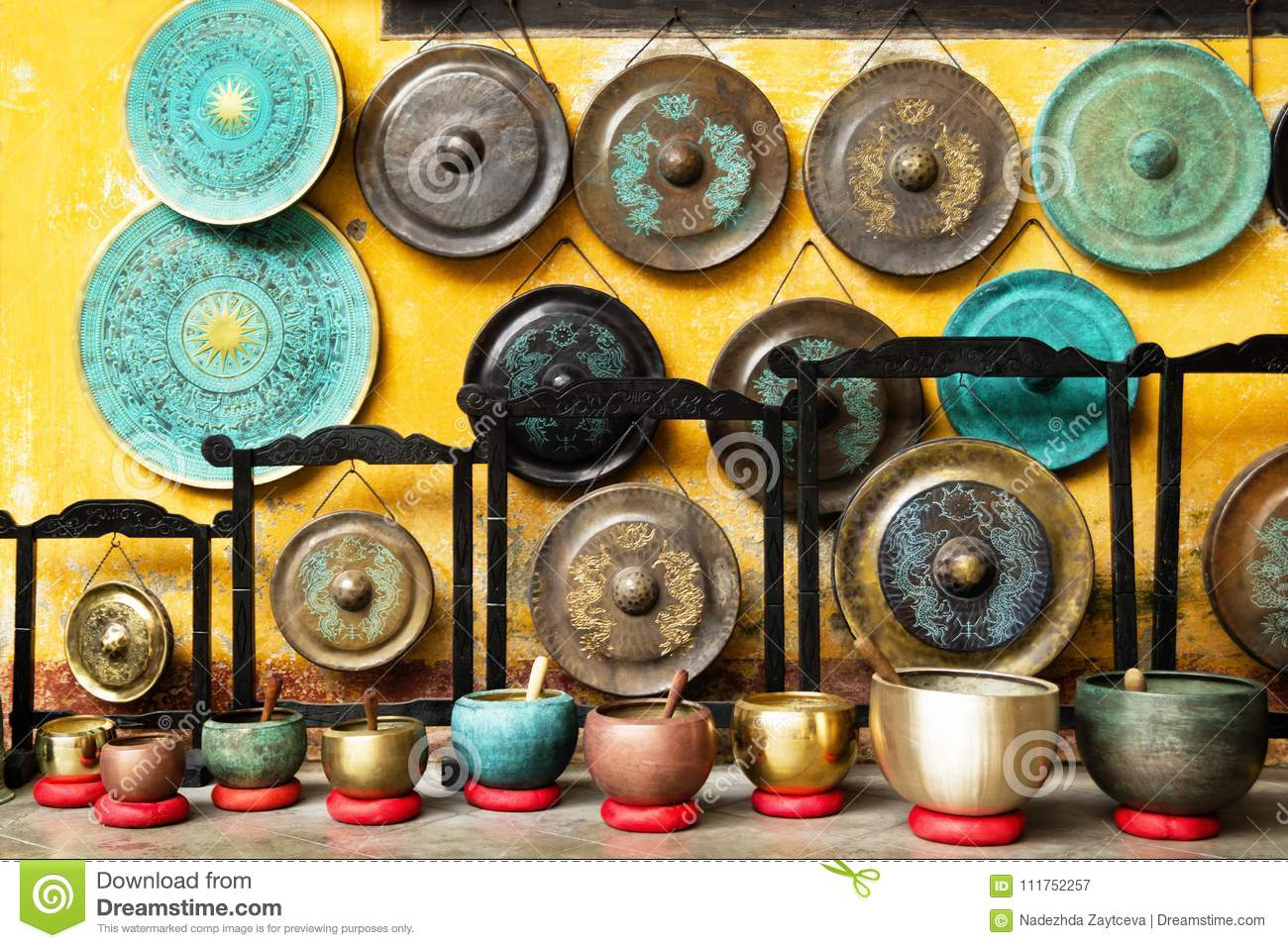 Gongs and singing bowls - traditional Asian musical instruments on a street market.