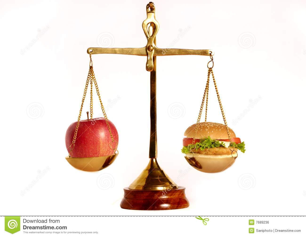 Apple and hamburger on a weight scales as concept for good and bad ...