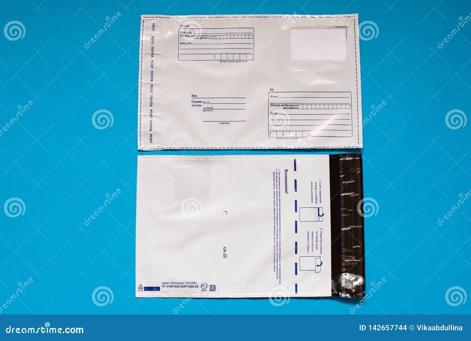 Russian post polyethylene envelope on blue background. Plastic Postal Mailing Bags