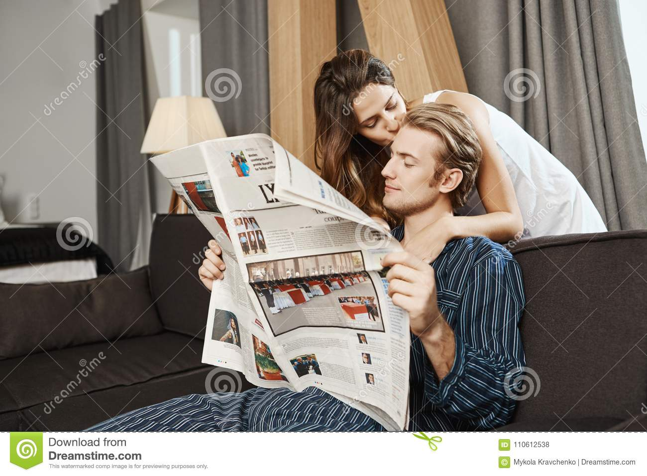 Good Looking Couple Reading Newspaper In Living Room Before Breakfast Handsome Guy Checking News When His Girlfriend Stock Photo Image Of Husband Couple 110612538