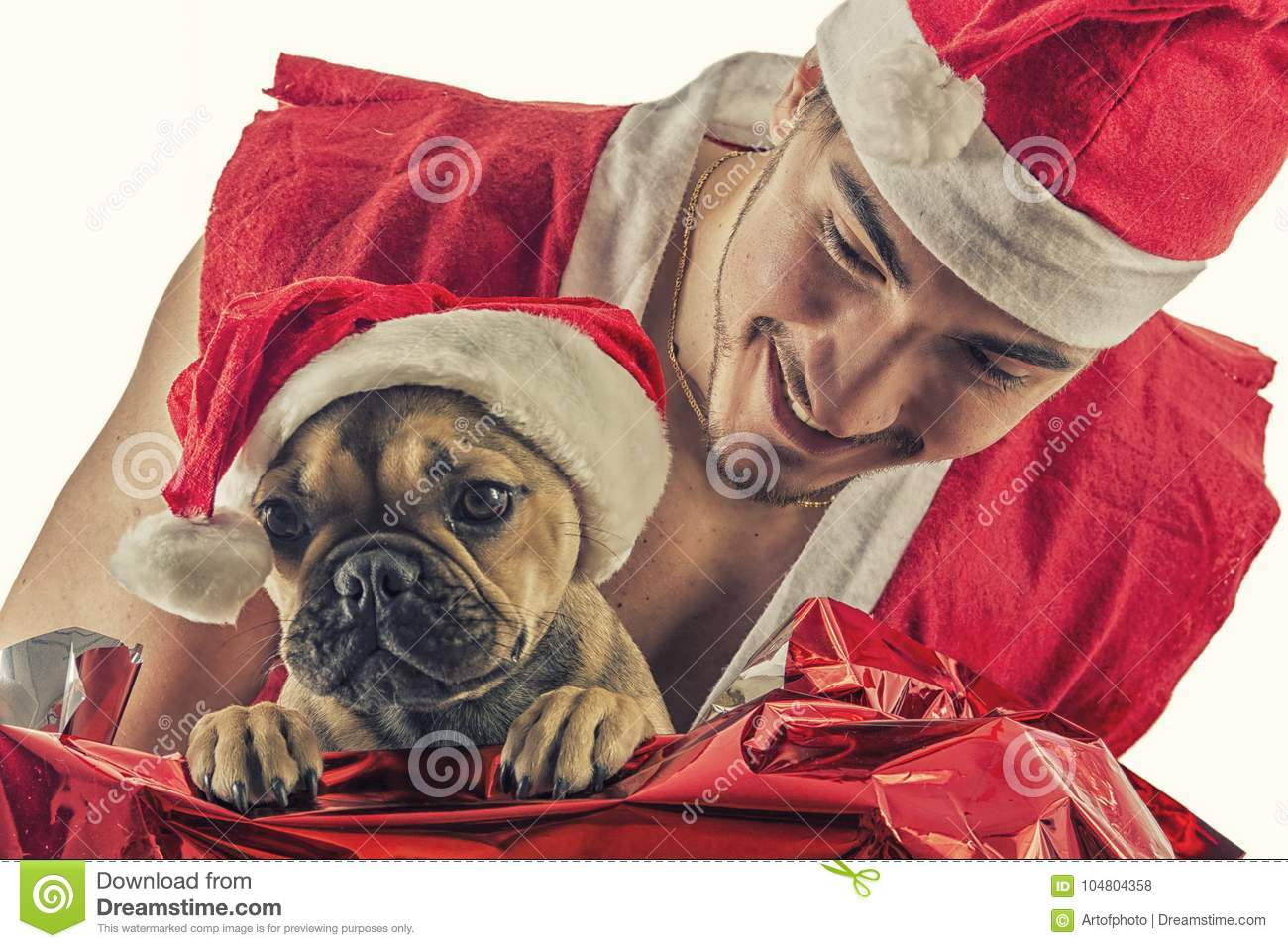 Good Looking Couple In Santa Claus Hat With Christmas Gift Stock ...