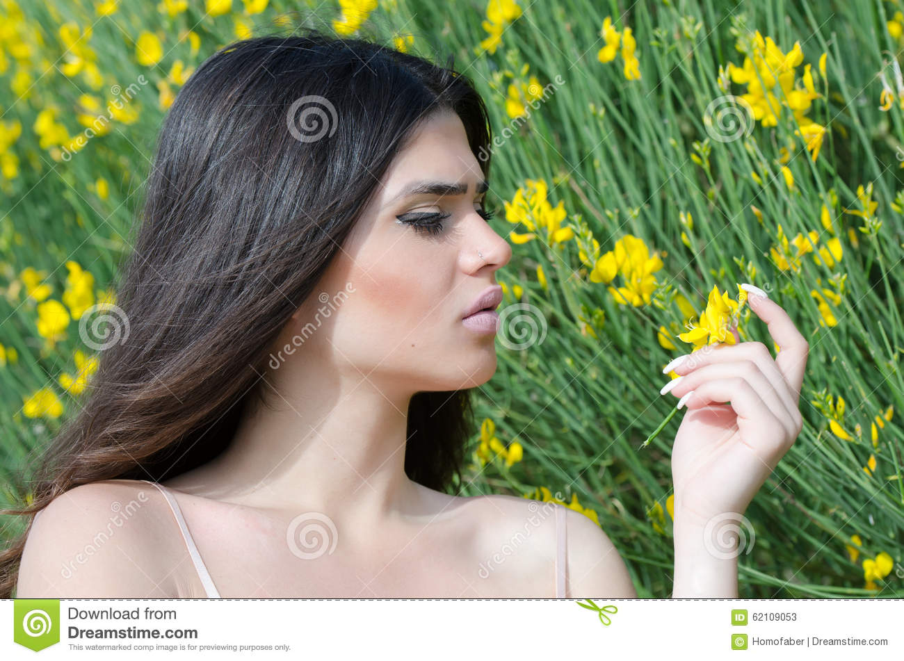 Uncategorized Good Smelling good looking lady smelling yellow flower stock image 62109053 flower
