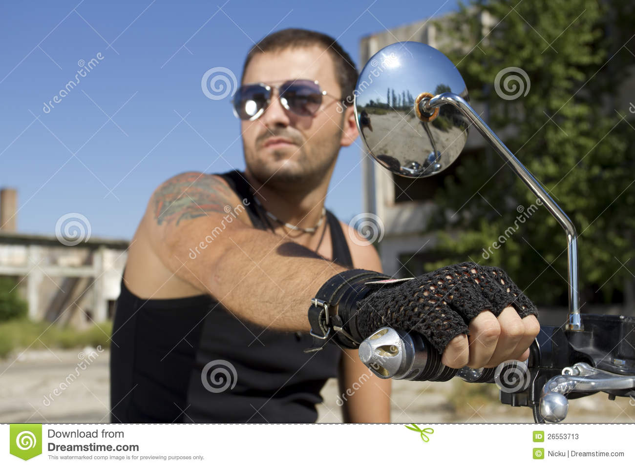 Good looking man holding a motorcycle handle