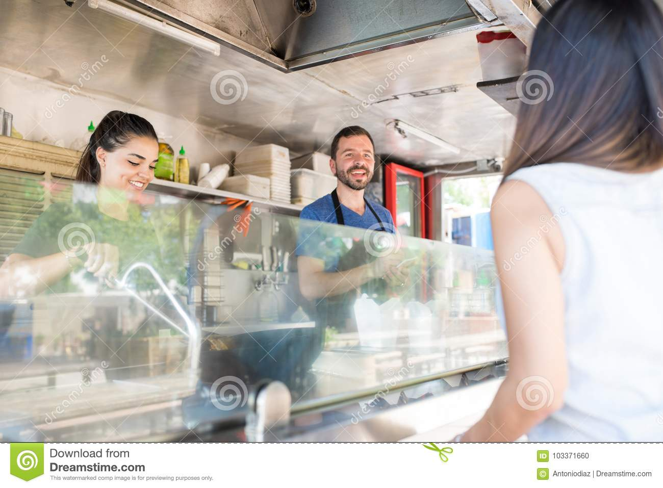 Taking an order in a food truck