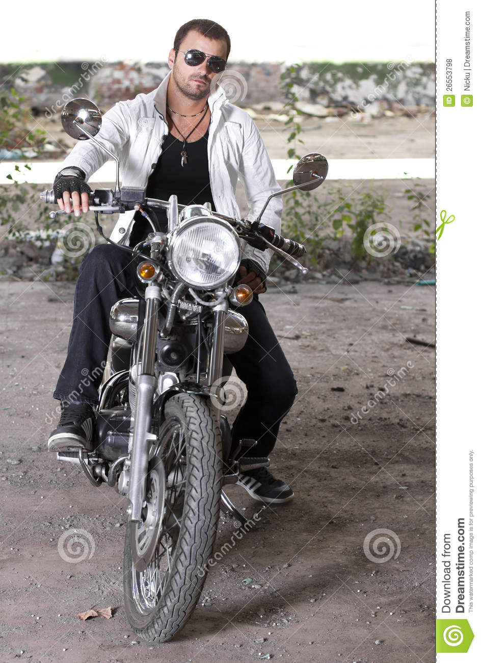 Good looking young man on motorcycle