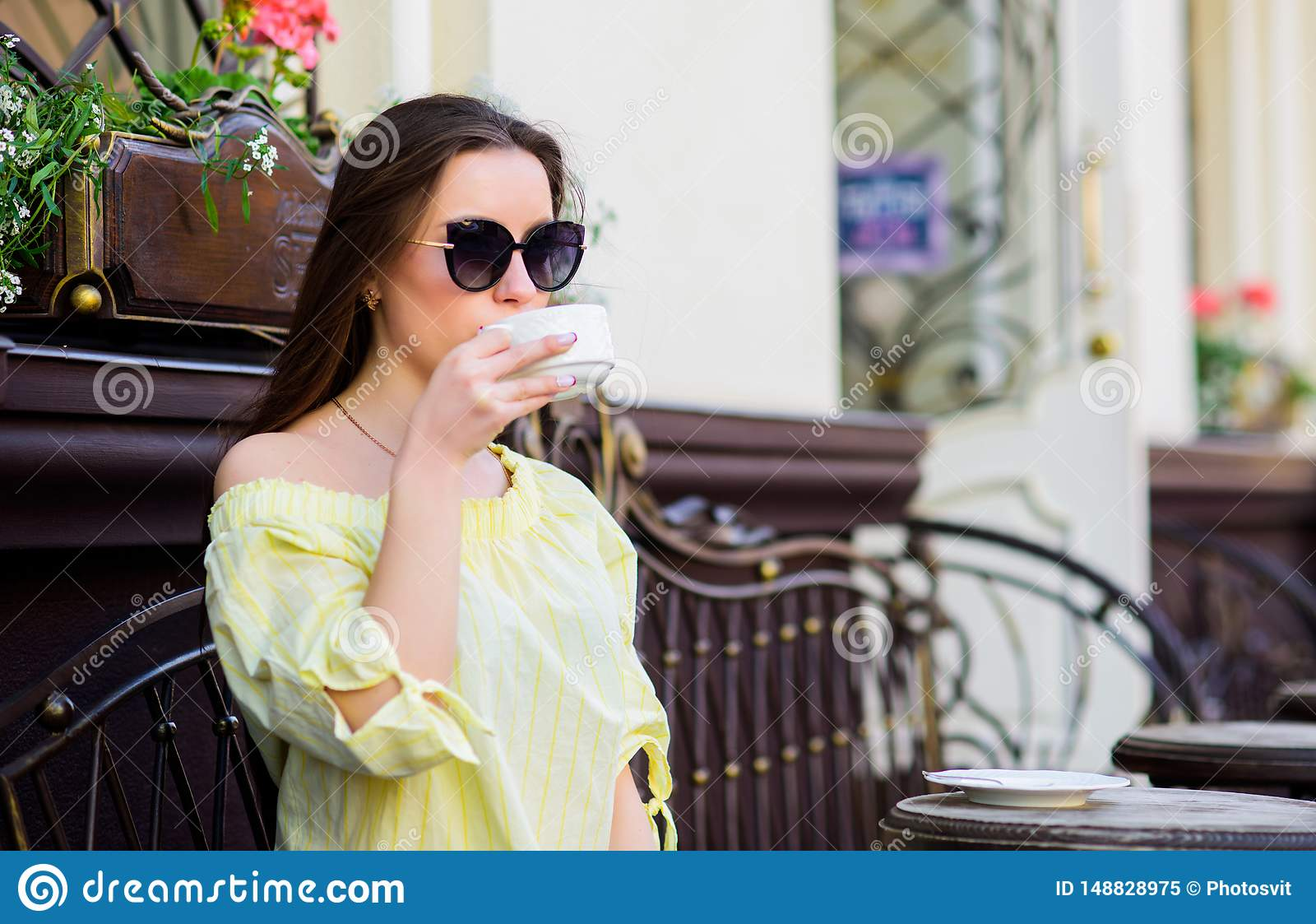Good morning. Breakfast. girl relax in cafe. Business lunch. stylish woman in glasses drink coffee. summer fashion