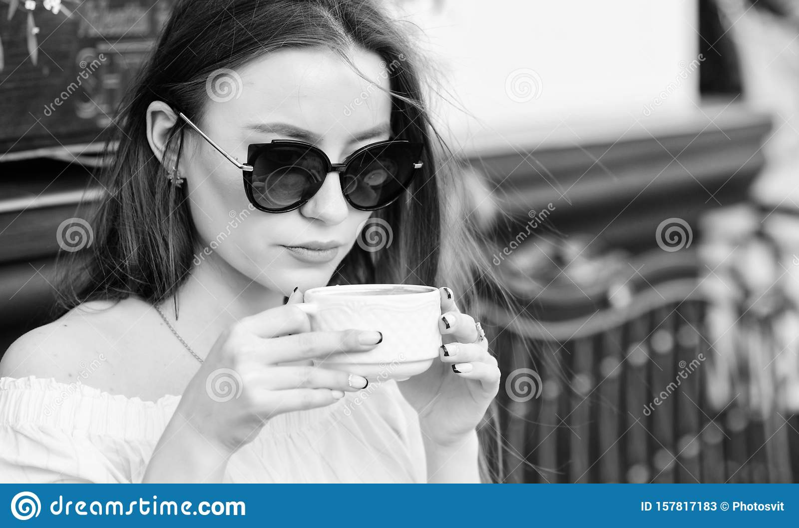 Good morning. Breakfast time. stylish woman in glasses drink coffee. girl relax in cafe. Business lunch. morning coffee